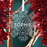 "A personalised snowflake shaped Christmas decoration with the name ""Sophie"" engraved on the front"