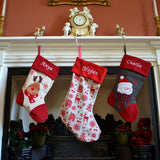 3 personalised Christmas stockings hanging on a mantle piece