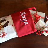 a close up of the embroidered name on a personalised Christmas stocking