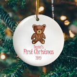 A personalised round Christmas tree decoration with a teddy bear printed on it