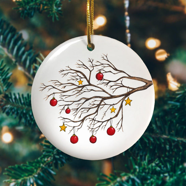 A personalised Christmas tree circle decoration with an illustration of a winter tree printed on it