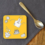A personalised yellow star baker coaster