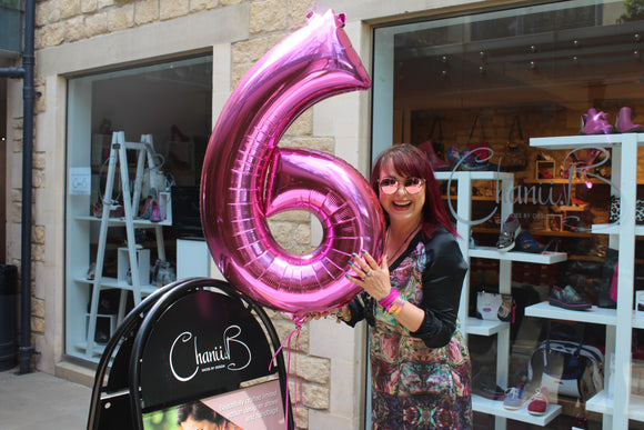 Celebrating our shop's birthday with a fuchsia balloon in true Chanii B style.