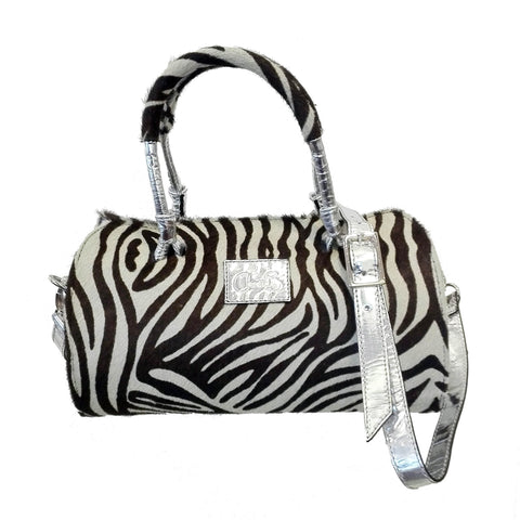 Zebra print leather bag. Double hand and safe zip compartment. Made from cow hide.