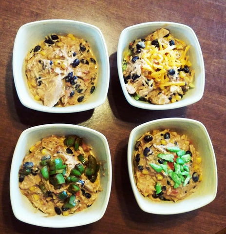 4 bowls of chicken chili with different toppings