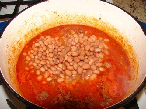 2 cans of pinto beans added to pot of chili