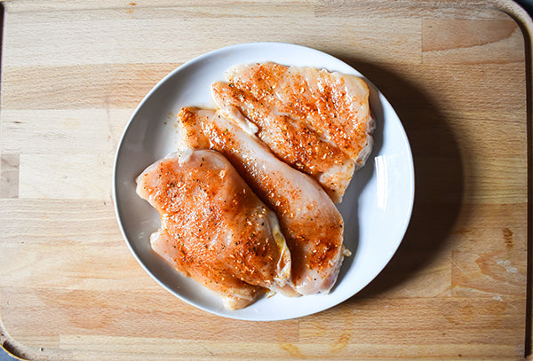 raw chicken breasts seasoned with chugwater chili dip & Dressing mix and olive oil