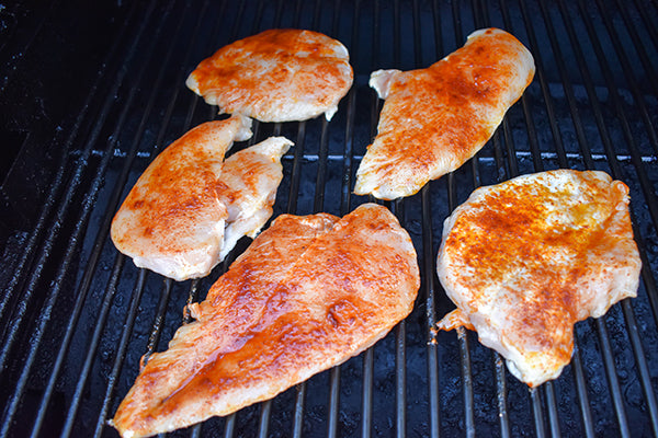 Chugwater Chili seasoned breasts on grill