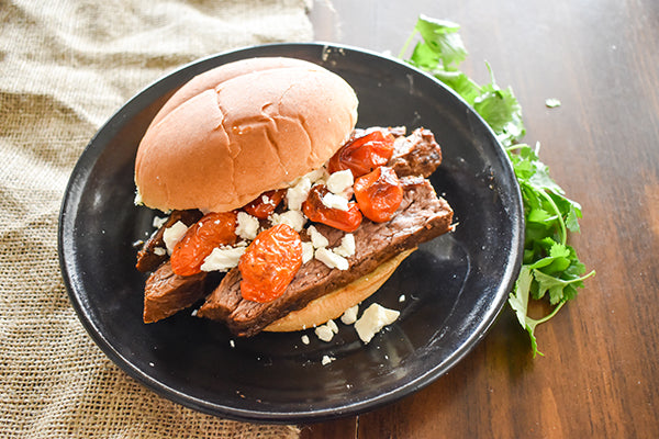 Flank Steak Sandwich with feta and roasted tomatoes