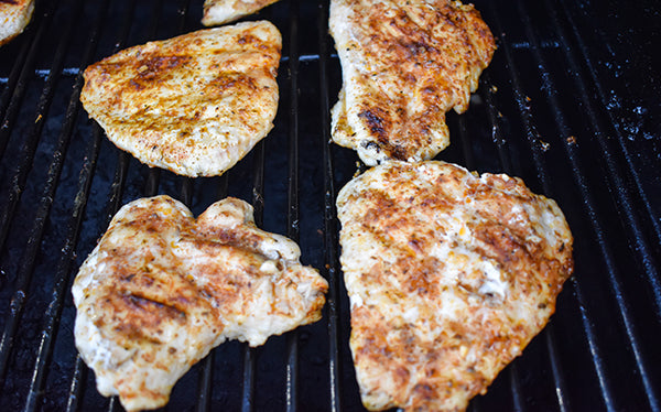 southwest seasoned chicken breasts on grill