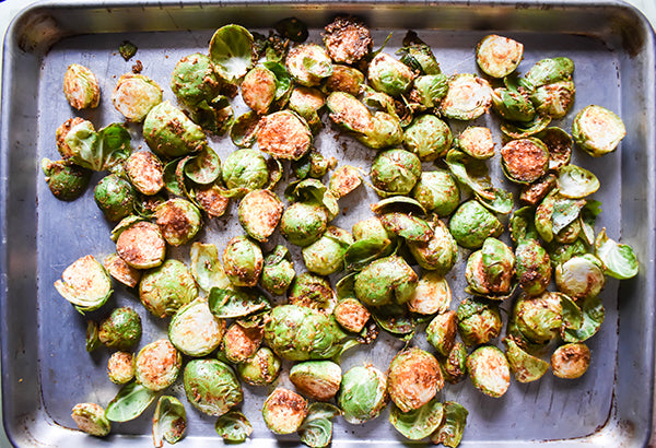 seasoned brussel sprouts on baking sheet