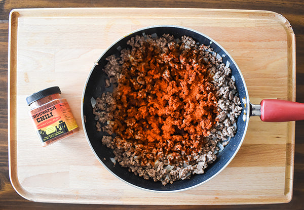 Chugwater Chili Seasoning added to browned beef in skilllet