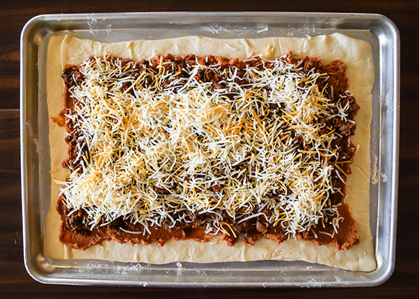 shredded fiesta blend cheese added on top of the taco pizza