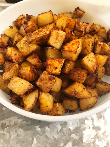 Seasoned potatoes in bowl