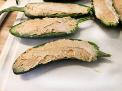 image of jalapenos stuffed with dip and dressing mix cream cheese