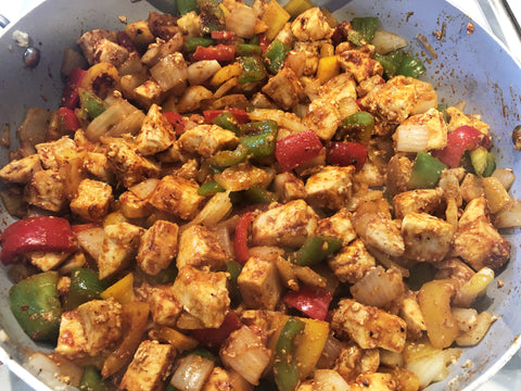 photo of chicken breast, peppers, and onion tossed in chili seasoning