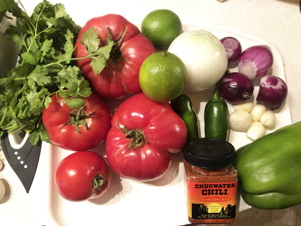 Tomatoes, Jalapenos, Garlic, Onion, Cilantro, Limes, Chugwater Chili Gourmet Blend jar, on board