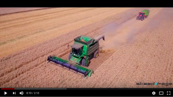 Aerial footage of us combining our winter wheat on Mound Field