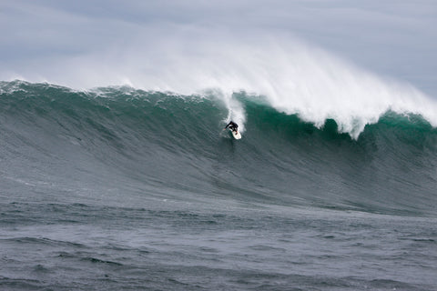 Mike Schlebach surfing a massive wave at dungeons