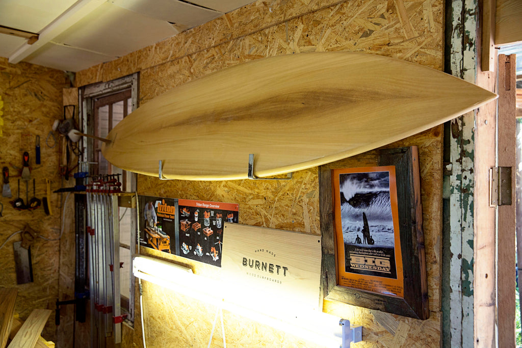 Wooden Surfboard hanging on the wall