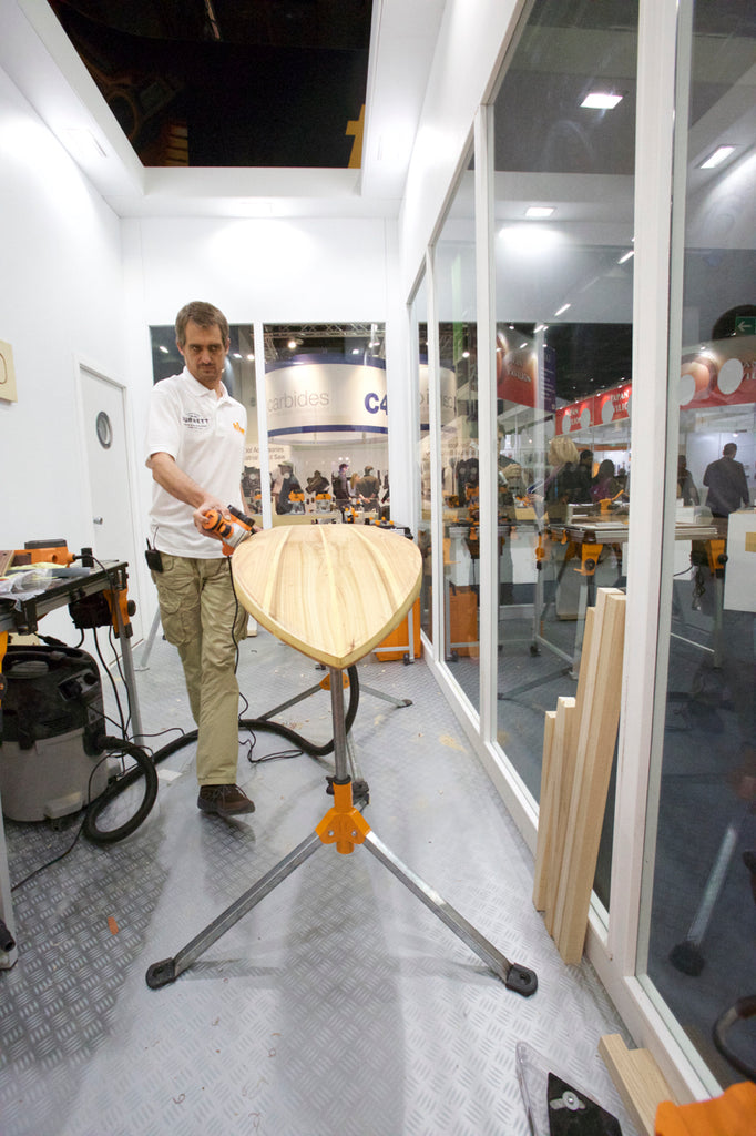 Sealand Gear Ambassador Patrick Burnett Shaping a wooden surfboard