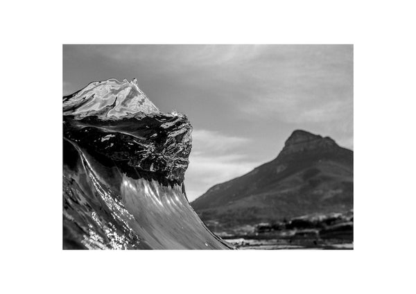 Black and white glassy wave lurching with Lion's Head in the background