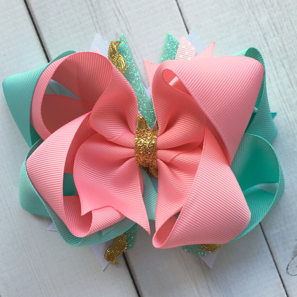 Gorgeous double stacked boutique hairbow for girls, toddlers and babies. FIlled with pink, aqua and gold glitter accent ribbon.