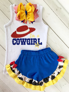 Disney outfits for girls, Disney outfits for toddlers inspired by Toy Story. I'm A Cowgirl in all glitter with personalized badge! Royal blue Toy Story inspired Shorts with cowhide and yellow check ruffles, finished off with red bows on either side.