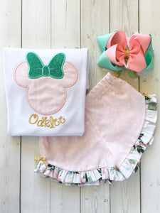 Gorgeous Disney outfit for girls, toddlers and babies. Minnie-like silhouette done in pretty pink flower petals and aqua glitter bow. Matching petals and floral ruffled shorts are perfection!