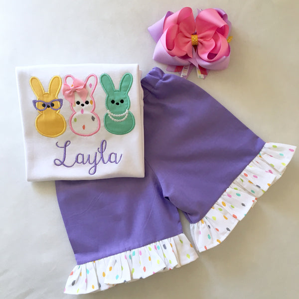 Girls easter outfit with shirt and ruffled shorts and easter bow. Shirt embroidered with three decorated bunnies inspired by Peeps! Lavender shorties finished with a confetti top ruffle.