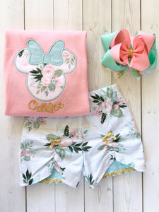 Gorgeous Disney outfit for girls, toddlers and babies. Minnie-like silhouette done in pretty floral fabir and aqua dot bow. Matching floral peek a boo shorts are perfection!