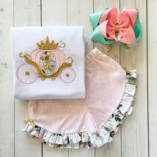 Gorgeous princess outfit for girls, toddlers and babies. Cinderella -like carriage done in pink petals, topped with gold glitter crown. Ruffled shorts are perfection in pink petal fabric finished with floral ruffles and gold bows.
