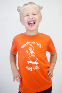 They See Me Rollin' kids skateboarding skeleton kids Halloween graphic tee