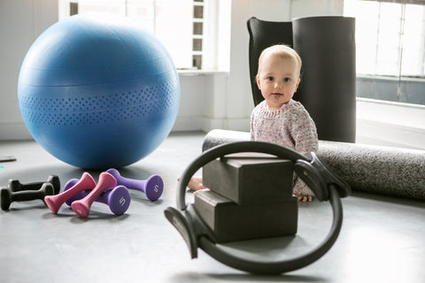 Postnatal workout program props include mat, physioball, ring, weights, blocks and foam roller