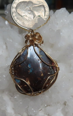 """Turn up the Lights"" for the full beauty of this Boulder Opal pendant and chain."