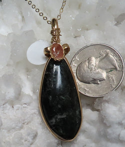 """Sun and Grass"" This pendant is a Green Kyanite with a Sunstone accent and Chain."