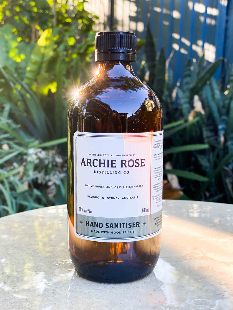Archie rose hand sanitiser bottle in natural setting. Perth Fremantle Flower delivery, eco locally grown Australian native flowers in concrete pot. Handmade. Hand delivered perth. Perth gift Delivery. Mothers Day