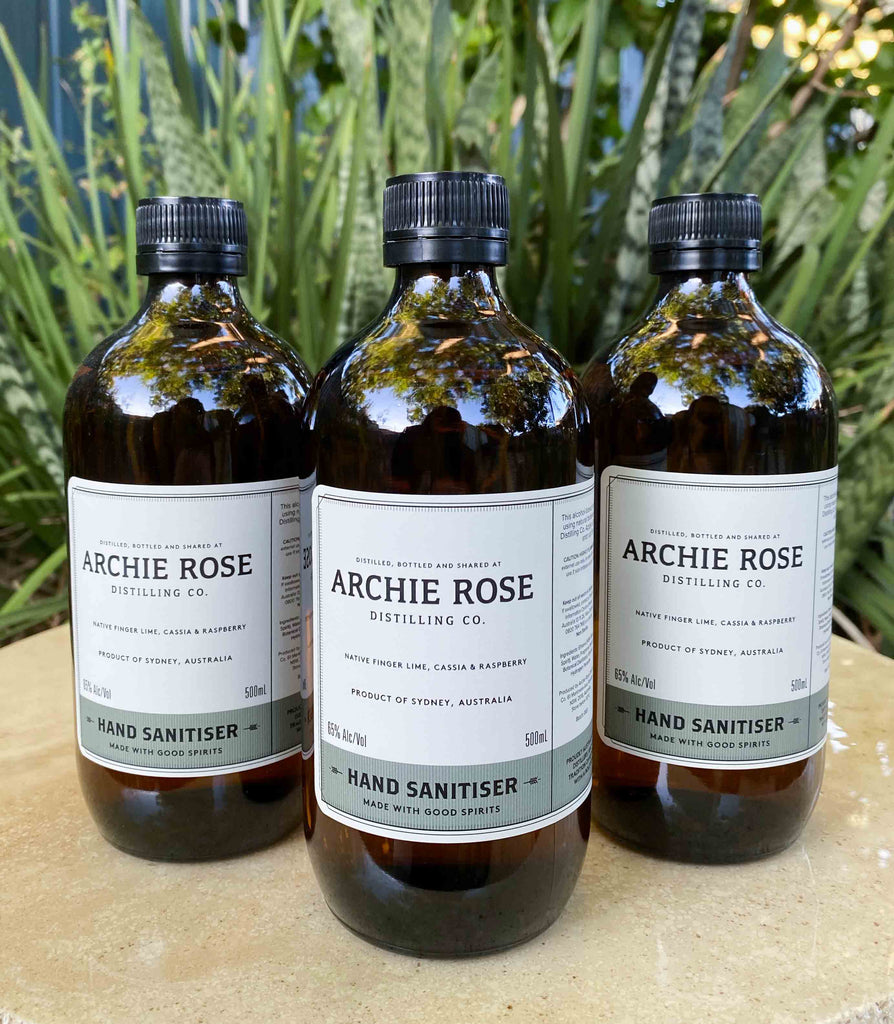 3 Archie rose hand sanitiser bottles in natural setting. Perth Fremantle Flower delivery, eco locally grown Australian native flowers in concrete pot. Handmade. Hand delivered perth. Perth gift Delivery. Mothers Day