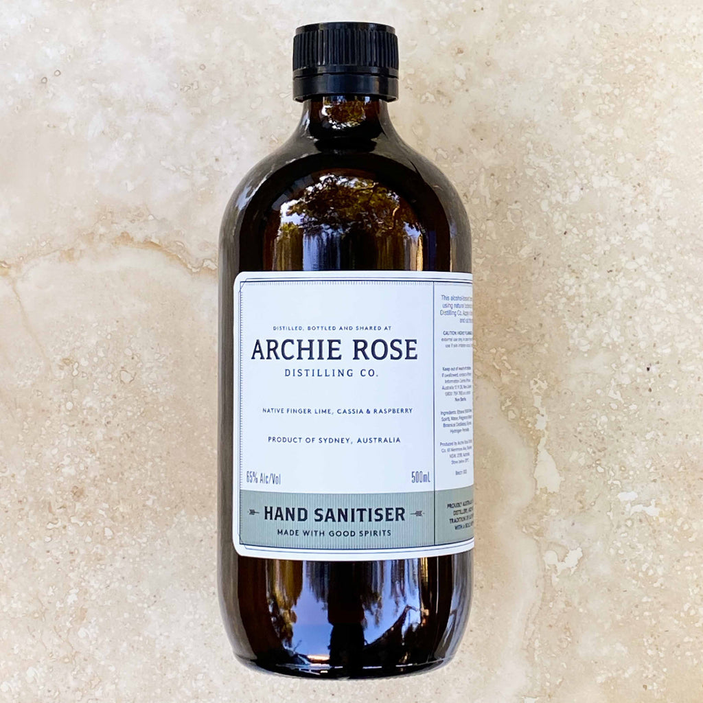 Archie Rose Distilling CO Hand Sanitiser. Natural Stone background. Perth Fremantle Flower delivery, eco locally grown Australian native flowers in concrete pot. Handmade. Hand delivered perth. Perth gift Delivery. Mothers Day