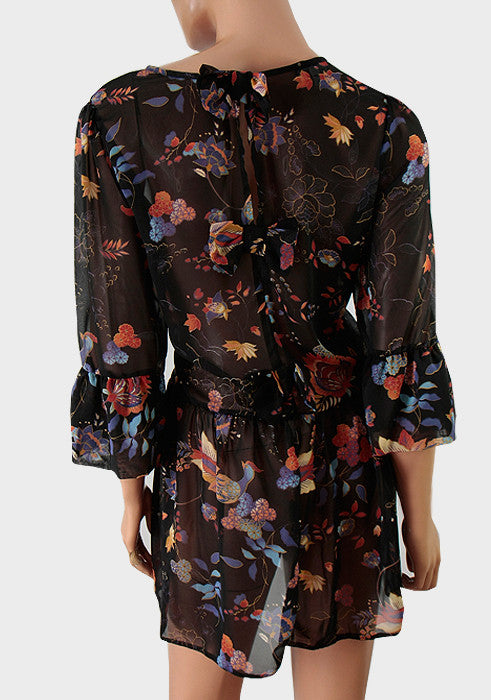 Women's fashion tunic in black chiffon with a autumnal floral print.  3/4 length sleeves & frill cuffs - Front
