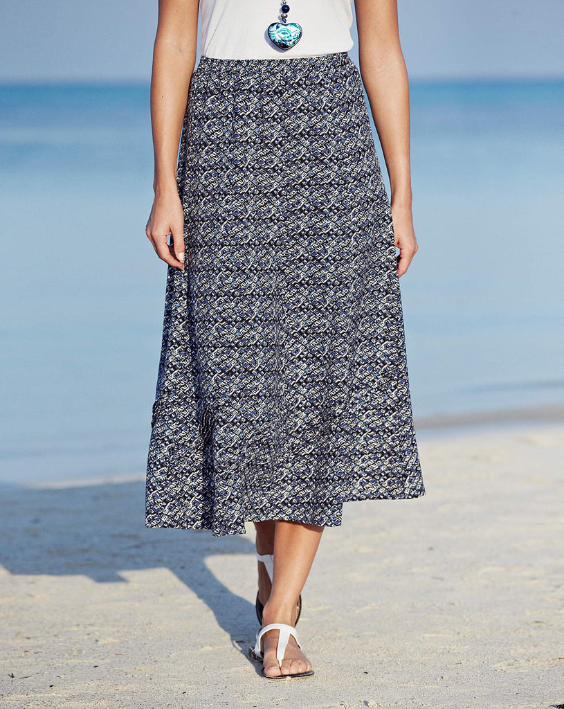 Women's fashion skirt, linen blend in a navy pattern with pin tuck detailing to hem - front