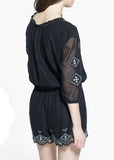 Women's Fashion playsuit in black with embroidery detail to the bust & leg hem - back