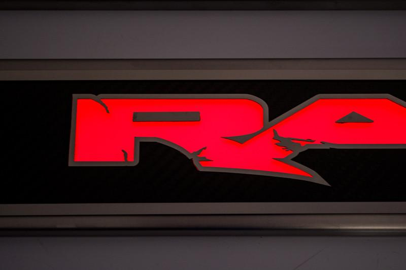 "2010-2014 Ford Raptor - Front Carbon Fiber/Fiberglass Door Sills with Illuminated ""Raptor"" Lettering 2Pc American Car Craft"