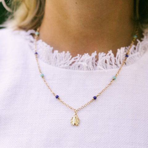 Tiny Goldbug on Blue Bead Chain