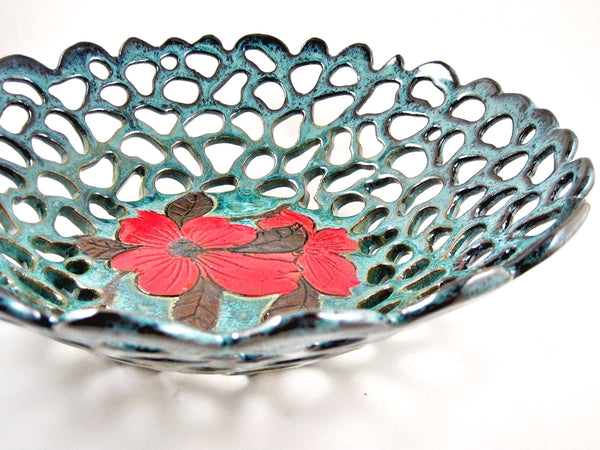 Teal blue fruit bowl with dogwood flower