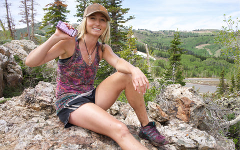 Woman Hiking and Running with Defense Alert Device