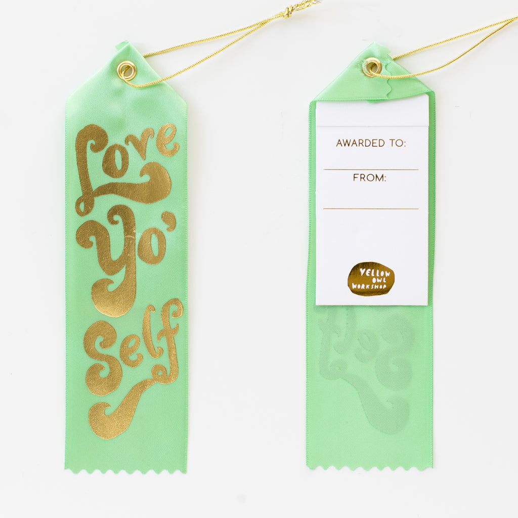 Luxe mint green satin award ribbon with 'Love Yo' Self' gold foil lettering