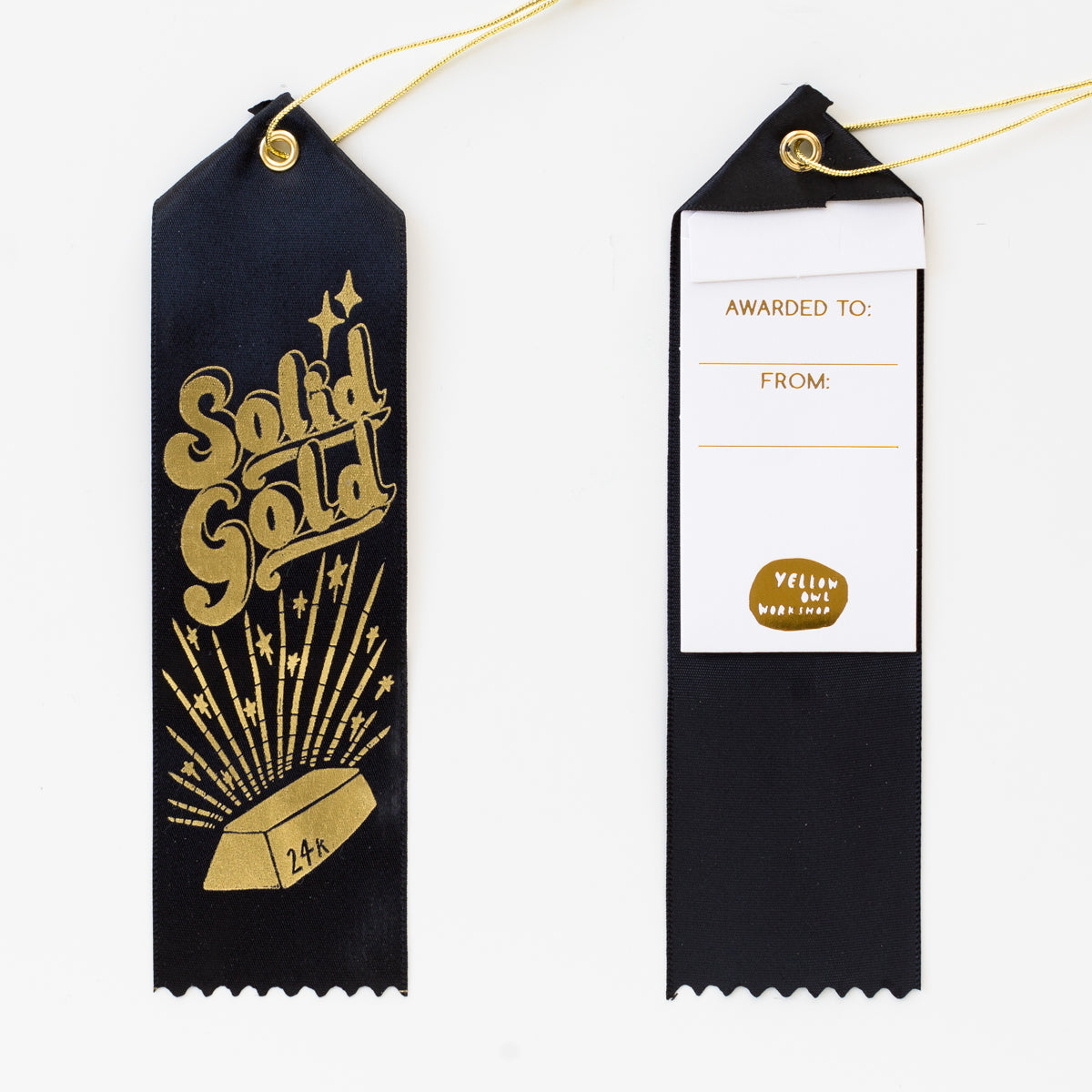 "Black satin award ribbon featuring a gold foil design of a 24k gold bar and the words ""solid gold""."