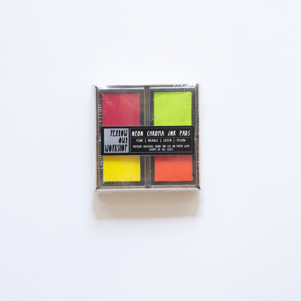 4 pack of small neon colored stamp ink pads. Includes Green, Orange, Yellow, and Pink.
