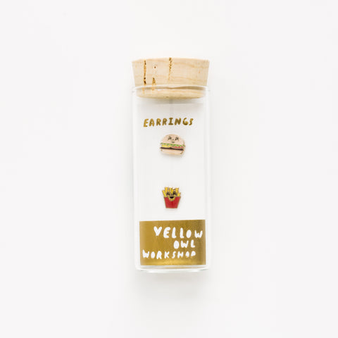 Burger and Fries mismatched enamel stud earrings packaged in a vial with a cork.